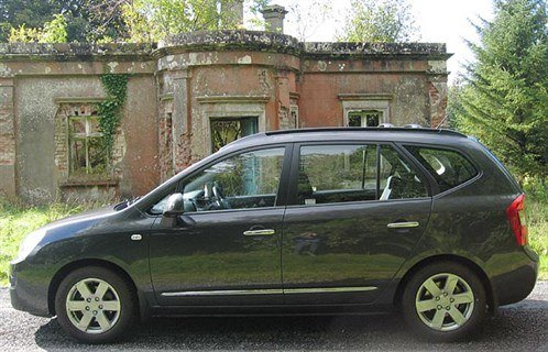 KIA Carens 07 Side 700