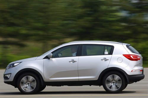KIA Sportage 10 Action Side 700